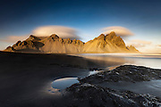 The magnificent Vestrahorn mountain seen from the black sand at Stokksnes beach in south east Iceland.