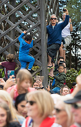 People try to get a view of the Duke and Duchess of Sussex during a walkabout in Rotorua on day four of the royal couple's tour of New Zealand.