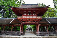 """Hyozu Taisha Shrine  Gate - It is said that Hyozu Taisha Shrine in Shiga was founded during the Nara period. its name literally means """"the master of soldiers"""" it had been worshipped by the Imperial Court and the warrior class. It is said to have been dedicated by Ashikaga Takauji and the Japanese ink writing on a rafter shows that it was constructed in 1550 and is prefecturally designated as a tangible cultural property. The shrine's magnificent garden was constructed during the Heian period and is considered to be a pond-strolling garden. The ground covered with a moss carpet is especially vibrant during the rainy season."""