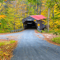 The iconic Durgin Covered Bridge framed by New England fall foliage. Durgin Covered Bridge spans the Cold River and is located in Sandwich, New Hampshire.<br />