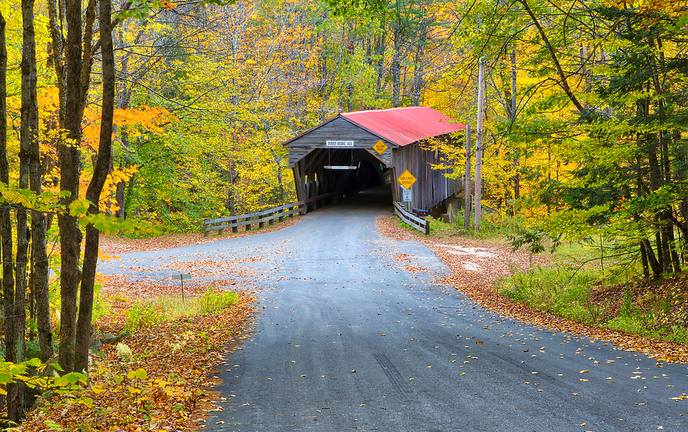 The iconic Durgin Covered Bridge framed by New England fall foliage. Durgin Covered Bridge spans the Cold River and is located in Sandwich, New Hampshire.<br /> <br /> New England fall foliage and Durgin Covered Bridge photography images are available as museum quality photography prints, canvas prints, acrylic prints or metal prints. Prints may be framed and matted to the individual liking and decorating needs:<br /> <br /> https://juergen-roth.pixels.com/featured/durgin-covered-bridge-juergen-roth.html<br /> <br /> All high resolution New Hampshire Covered Bridge photography images are available for photo image licensing at www.RothGalleries.com. Please contact me directly with any questions or request. <br /> <br /> Good light and happy photo making!<br /> <br /> My best,<br /> <br /> Juergen<br /> Prints: http://www.rothgalleries.com<br /> Photo Blog: http://whereintheworldisjuergen.blogspot.com<br /> Instagram: https://www.instagram.com/rothgalleries<br /> Twitter: https://twitter.com/naturefineart<br /> Facebook: https://www.facebook.com/naturefineart