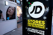 Advertfor JD Sports in Oxford Street shopping district as Londoners await the imminent end of the second coronavirus national lockdown before the capital enters tier two in the new three tier system on 1st December 2020 in London, United Kingdom. Non essential shops will be allowed to reopen as of 2nd December while in other areas of the country, controversially, they will have to remain closed.