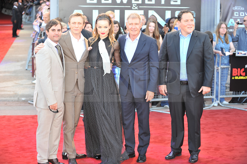 © Licensed to London News Pictures. 11/08/2011. London, England.Daniel Craig  Olivia Wilde Harrison Ford and director Jon Favreau attends the U.K premiere of Cowboys and Aliens Starring Harrison Ford and Daniel Craig at the O2 Cineworld London Photo credit : ALAN ROXBOROUGH/LNP