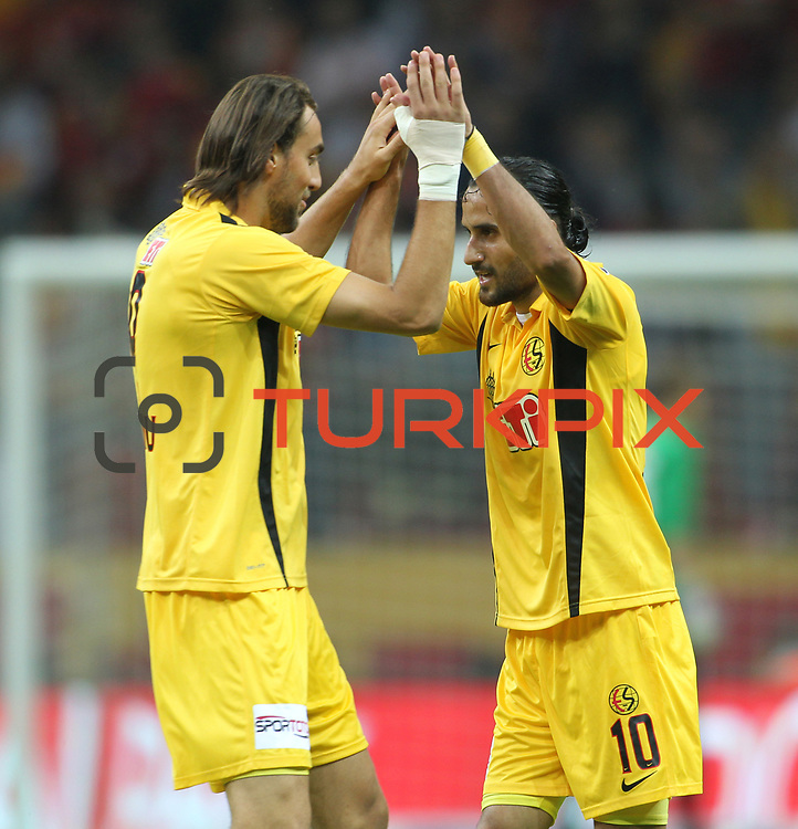 Eskisehirspor's Atdhe Nuhiu with Erkan Zengin (R) celebrates his goal during their Turkish Super League soccer match Galatasaray between Eskisehirspor at the TT Arena at Seyrantepe in Istanbul Turkey on Saturday, 06 October 2012. Photo by TURKPIX