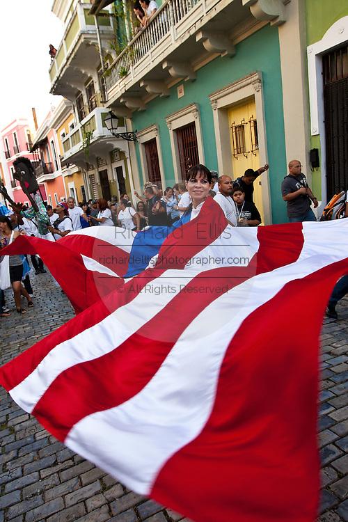 A Costumed reveler parades during the Festival of San Sebastian in San Juan, Puerto Rico.