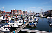 The marina with pleasure crafts and small fisher boats in Scheveningen, The Hague, Netherlands.