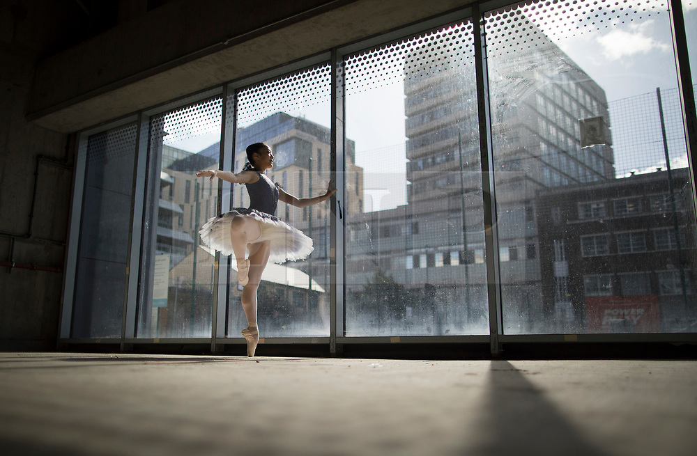 © Licensed to London News Pictures. 21/03/2017. London, UK. A performer strikes a pose in the window of The Central School of Ballet's newly announced building in central London. The dancers wear costumes from their forthcoming nationwide Ballet Central tour 2017 against the backdrop of the unfinished interior of the new premises. Photo credit: Peter Macdiarmid/LNP
