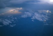 Light beams through these clouds shot from an airplane.