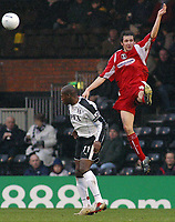 Photo: Paul Thomas.<br />Fulham v Leyton Orient. The FA Cup. 08/01/2006.<br /><br />Orients first goal scorer Craig Easton competes in the air with Fulham's Luis Boa Morte.