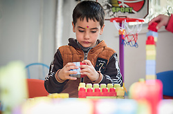 17 February 2020, Zarqa, Jordan: A boy plays in 'the nanny room' at the Lutheran World Federation community centre in Zarqa. Through a variety of activities, the Lutheran World Federation community centre in Zarqa serves to offer psychosocial support and strengthen social cohesion between Syrian, Iraqi and other refugees in Jordan and their host communities.