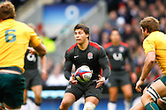 Ben Youngs of England passes the ball under Australian pressure during the Investec series international between England and Australia at Twickenham, London, on Saturday 13th November 2010. (Photo by Andrew Tobin/SLIK images)