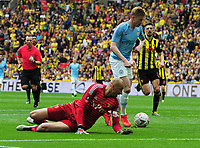 Football - 2019 Emirates FA Cup Final - Manchester City vs. Watford<br /> <br /> Kevin de Bruyne of Man City goes round goalkeeper, Heurelho Gomes to score goal number 3, at Wembley Stadium.<br /> <br /> COLORSPORT/ANDREW COWIE