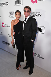 Lisa Rinna (left) and Harry Hamlin attending the Elton John AIDS Foundation Viewing Party held at West Hollywood Park, Los Angeles, California, USA.