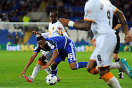 Cardiff City's Kagisho Dikgacoi (blue) is challenged by Hull's Moses Odubajo. Skybet football league championship match, Cardiff city v Hull city at the Cardiff city stadium in Cardiff, South Wales on Tuesday 15th Sept 2015.<br /> pic by Carl Robertson, Andrew Orchard sports photography.