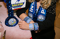 LUGO, ITALY - 5 JANUARY 2020: Clara Agnoletti, a longtime supporter of the League, shows signs and bracelets of the party that she personalized with Swarovski crystals as she waits for Matteo Salvini, former Interior Minister of Italy and leader of the far-right League party, to show up for a party dinner in Lugo, Italy, on January 5th 2020.<br /> <br /> Matteo Salvini is campaigning in the region of Emilia Romagna to support the League candidate Lucia Borgonzoni running for governor.<br /> <br /> After being ousted from government in September 2019, Matteo Salvini has made it a priority to campaign in all the Italian regions undergoing regional elections to demonstrate that, in power or not, he still commands considerable support.<br /> <br /> The January 26th regional elections in Emilia Romagna, traditionally the home of the Italian left, has been targeted by Matteo Salvini as a catalyst for bringing down the government. A loss for the center-left Democratic Party (PD) against Mr Salvini's right would strip the centre-left party of control of its symbolic heartland, and probably trigger a crisis in its coalition with the Five Star Movement.