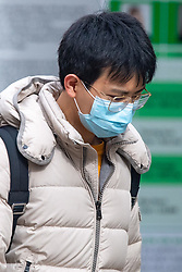 © Licensed to London News Pictures. 09/03/2020. Oxford, UK. A young man wears a face mask in central Oxford as the COVID-19 coronavirus continues to spread across the United Kingdom. Photo credit: Peter Manning/LNP