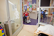 30 DECEMBER 2009 -- PHOENIX, AZ:  Mackenzie Saunders (CQ) heads to her physical therapy at St. Joseph's Hospital in Phoenix Wednesday. Mackenzie was knocked down by another player during a soccer game. She finished the game but later in the day her legs started hurting and her parents took her to a hospital. Three hospitals later, she was in St. Joseph's with a diagnosis of a swollen spine and she couldn't walk. Now she's in physical therapy. She is expected to make a full recovery but her doctors have said she won't be able to play soccer for at least another 16 months.    Photo by Jack Kurtz