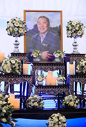 A floral tribute inside with the book of condolence for Leicester Chairman Vichai Srivaddhanaprabha at Leicester City Football Club.