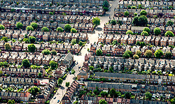 File photo dated 19/01/16 of terraced houses. The North-South house price divide will turn on its head over the next five years, a report predicts - with property values rising at a faster rate in northern England, Wales and Scotland than those across London.