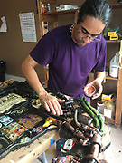 Cuban artist Julio Cepeda from Trinidad, Cuba, GoggleWorks Artist in Residence, prepares a found object mural for West Reading, Elm St. program, Berks Co., PA