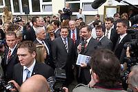 12 MAY 2004, LUDWIGSFELDE/GERMANY:<br /> Gerhard Schroeder (M), SPD, Bundeskanzler, Manfred Stolpe (L), SPD, Bundesverkehrsminister, und Matthias Platzeck (R), Ministerpraesident Brandenburg, umgeben von Journalisten, Personenschuetzern und einigen Schuelern, waehrend dem Besuch der Gesamtschule Ludwigsfelde<br /> Gerhard Schroeder, Federal Chancellor, is visiting a school near Berlin<br /> IMAGE: 20040512-02-012<br /> KEYWORDS: Gerhard Schröder, Schule, Schüler, Fotografen, photographer, pupil, pupils