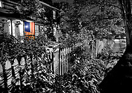 An American flag is proudly displayed on a quiet, warm 4th of July evening.   Aspect Ratio 1w x 0.703h