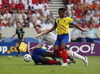 Photo: Chris Ratcliffe.<br /> England v Ecuador. 2nd Round, FIFA World Cup 2006. 25/06/2006.<br /> Wayne Rooney of England clashes with Ivan Hurtado (R) and Giovanny Espinoza of Ecuador.