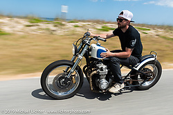 Mike Hendriks riding his 1976 CB550 Honda down A1A during Daytona Bike Week. FL. USA. Sunday March 18, 2018. Photography ©2018 Michael Lichter.