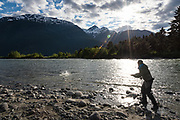 Afternoon sun over Manitou Peak lights up the water as David Page does battle with a Dean River chinook.