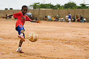 A boy plays soccer in Accra, Ghana on Tuesday June 16, 2009.