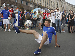 May 25, 2018 - Kiev, Ukraine - A man play football at the UEFA Champions League Final fan zone in Kyiv, Ukraine, 25 May, 2018. Real Madrid will face Liverpool FC in the UEFA Champions League final at the NSC Olimpiyskiy stadium on 26 May 2018. (Credit Image: © Str/NurPhoto via ZUMA Press)