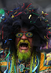 A Brazil fan in the stands celebrates victory over Mexico