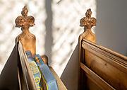 Village parish church Parham, Suffolk, England, UK carved decorated pew poppyhead ends