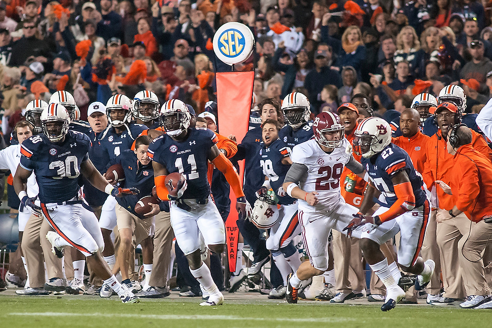 Auburn's Chris Davis (11) outruns Alabama defenders to return a missed field goal 109-yards for a touchdown as time expires to upset the top-ranked Crimson Tide. <br /> No. 1 Alabama Crimson Tide vs. No. 4 Auburn Tigers at Jordan-Hare Stadium in Auburn, Ala., on Saturday, Nov. 30, 2013. <br /> Zach Bland Photo