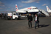Two male passnegrs walking from British Airways plane Marrakech airport, Morocco, north Africa