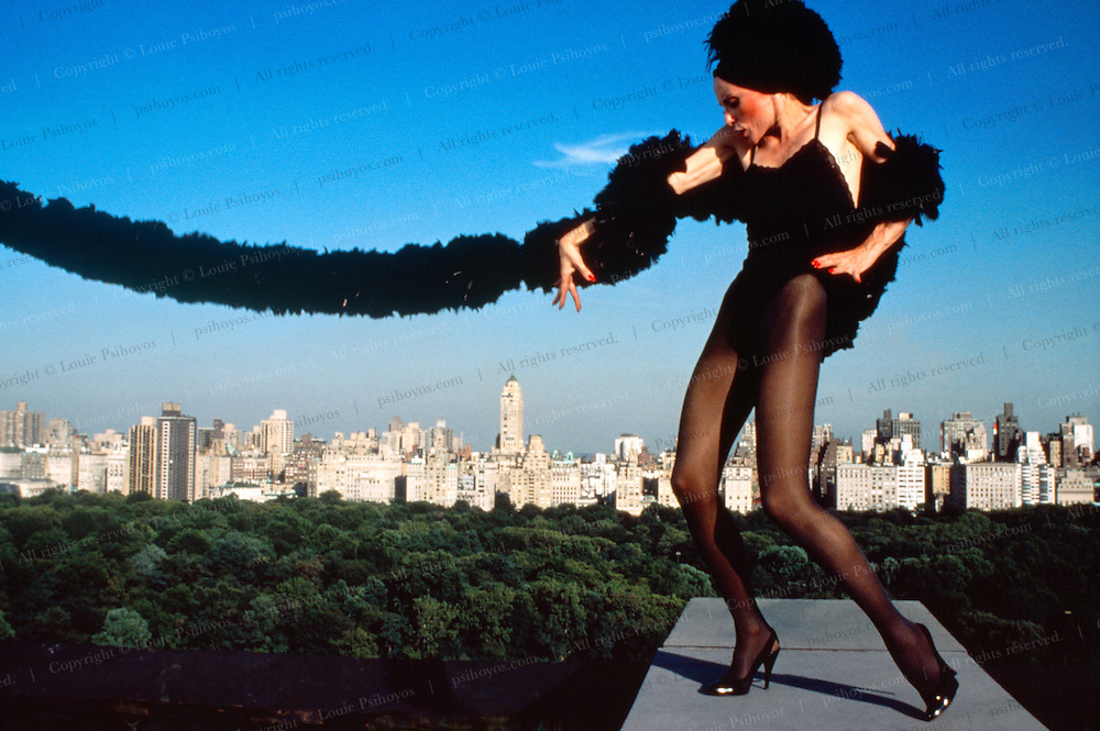 """Lillian Montevecchi acting out a scene from the play """"Nine"""" on the roof of a Central Park West Building."""