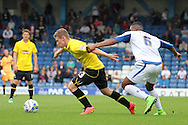 Burton Albion's Matty Palmer battles for the ball with Bury's Kelvin Etuhu (r). Skybet football league two match, Bury v Burton Albion at the JD Stadium, Gigg Lane in Bury, Lancs on Saturday 20th Sept 2014.<br /> pic by David Richards,  Andrew Orchard sports photography.