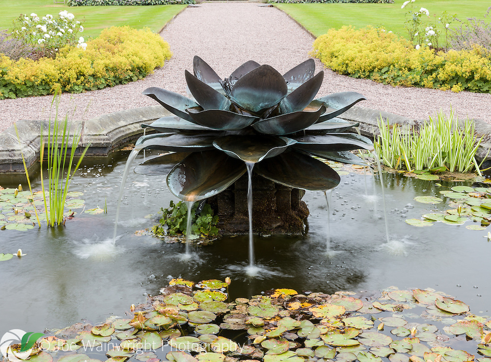 The fountain in the Walled Garden, at Arley Hall, Cheshire, was commissioned by the Friends of Arley Hall in memory of Lord Ashbrook's late mother. It was created by Tom Leaper and opened in 2006. . This image is available for sale for editorial purposes, please contact me for more information.