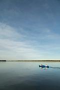 Tourists on canoe safari on lower Zambezi River in Zambia