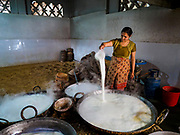 09 MARCH 2017 - BHAKTAPUR, NEPAL: Making yogurt in a home workshop in Bhaktapur, Nepal. Yogurt made in Bhaktapur is considered the finest yogurt in Nepal.     PHOTO BY JACK KURTZ