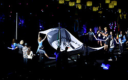 The Commonwealth Games Federation flag is carried during the Closing Ceremony for the 2018 Commonwealth Games at the Carrara Stadium in the Gold Coast, Australia.