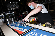 Chapelli's barman, James pours first drinks as the clock struck midnight during COVID-19 in Melbourne, Australia. Melbourne reopens. From midnight today, retail and hospitality are once again allowed to open their doors with tight restrictions in place. (Photo by Dave Hewison/Speed Media)