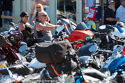 Riding down Lakeside Avenue in the Weir's Beach area during Laconia Motorcycle Week, New Hampshire, USA. Wednesday June 14, 2017. Photography ©2017 Michael Lichter.