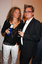 STEPHANIE THEOBALD social editor of Harpers & Queen and JUSTIN GAYNOR at a party to celebrate the publication of 'Shalimar The Clown' by Salman Rushdie, held at the David Gill Galleries, 3 Loughborough Street, London SE11 on 7th September 2005.<br /><br />NON EXCLUSIVE - WORLD RIGHTS