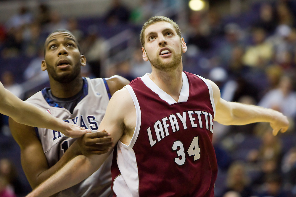 WASHINGTON - NOVEMBER 28: Jared Mintz #34 of the Lafayette Leopards battles for a rebound with Georgetown Hoya Greg Monroe #10 during a college basketball game on November 28, 2009 at Verizon Center in Washington DC.