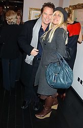MEG MATHEWS and JOHN HITCHCOX at the opening of an exhibition of paintings and watercolours by Raoul Dufy held at the Opera Gallery, 134 New Bond Street, London W1 on 6th February 2006.<br />