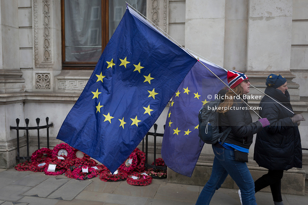 As the EU's Chief negotiator Michel Barnier meets Theresa May in London to discuss the next stage of Brexit, anti-Brexit protesters hold the stars of the EU flag in Whitehall and near Downing Street, the official residence of the Prime Minister, on 5th February 2018, in London England.