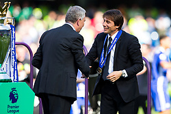 Chelsea manager Antonio Conte collects his winners medal from Premier League Executive Chairman Richard Scudamore as Chelsea celebrate winning the 2016/17 Premier League - Rogan Thomson/JMP - 21/05/2017 - FOOTBALL - Stamford Bridge - London, England - Chelsea v Sunderland - Premier League..
