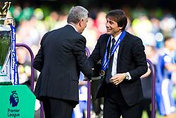 Chelsea manager Antonio Conte collects his winners medal from Premier League Executive Chairman Richard Scudamore as Chelsea celebrate winning the 2016/17 Premier League - Rogan Thomson/JMP - 21/05/2017 - FOOTBALL - Stamford Bridge - London, England - Chelsea v Sunderland - Premier League..