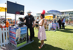 Ilda Di Vico places a bet at a Totepool station during day three of the Qatar Goodwood Festival at Goodwood Racecourse, Chichester.